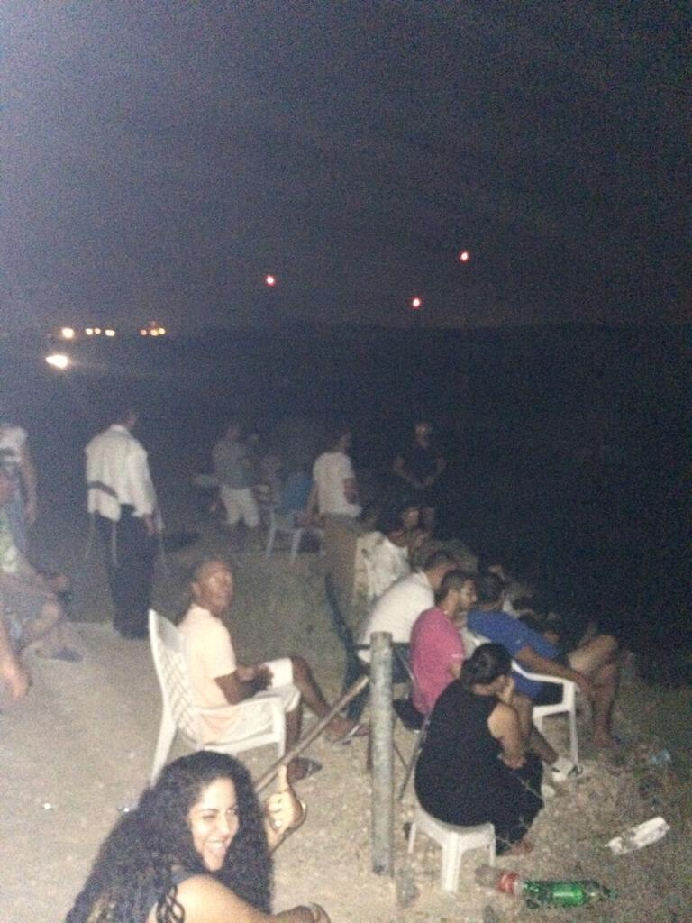 Israelis sit in lawn chairs and eat popcorn while cheering on the slaughter in Gaza